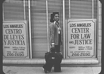 old image of woman in front of LACLJ office