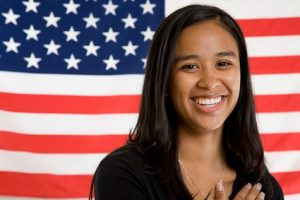 young woman in front of american flag